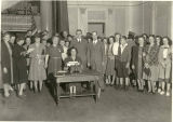 Typist among a group, largely women, in the Williamsport High School auditorium