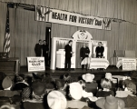 View of stage at first meeting of Health for Victory Club, March 21, 1941