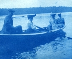 Unidentified man and three unidentified women in boat