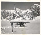 Don Sheldon and airplane at base camp, Ruth Glacier, Mt. McKinley Range, Alaska