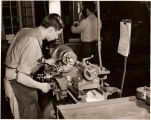 WTI Machine Shop Student Operating a Lathe