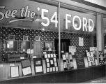 """See the '54 Ford"" sign"